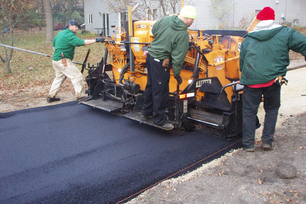 Crew laying asphalt in Bloomington, MN